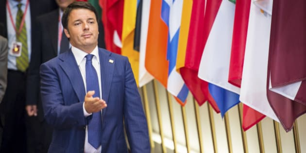 Italian Premier Matteo Renzi gestures as he leaves the EU Council building at the end of an EU summit in Brussels, early Sunday, Aug. 31, 2014. The European Union is giving Russia a one-week ultimatum to scale back its intervention in Ukraine or face additional economic sanctions. (AP Photo/Geert Vanden Wijngaert)