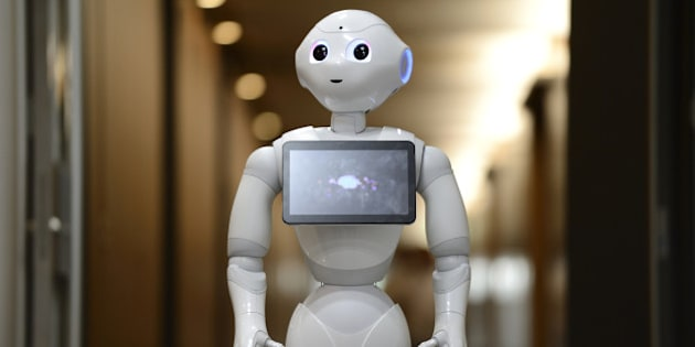 The humanoid robot Pepper, developed by SoftBank Corp.'s Aldebaran Robotics unit, stands in the SoftBank Robotics headquarters in Tokyo, Japan, on Monday, Sept. 1, 2014. Billionaire Masayoshi Son will start selling his humanoid robots at Sprint Corp. stores in the U.S. by next summer, part of SoftBank Corp.s push to take the technology beyond factory floors. Photographer: Akio Kon/Bloomberg via Getty Images