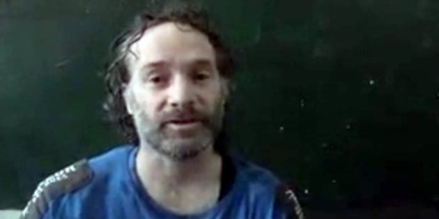 "In this image made from undated video obtained by The Associated Press, which has been authenticated based on its contents and other AP reporting, a man believed to be Peter Theo Curtis, a U.S. citizen held hostage by an al-Qaida linked group in Syria, delivers a statement. Journalists James Foley and Peter Theo Curtis all shared one thing in common when they were captured by Islamic militants in Syria, the title ""freelance journalist."" The role of freelancers, who make a living by selling individual stories to multiple outlets, has expanded across conflict zones in recent years with the spread of technology and social media. While some are cautious and well-trained, others take major risks in hopes of getting a picture or story that no one else has, and thus is more valuable. And they often lack the institutional support staff writers receive if they get into trouble in a conflict zone. (AP Photo)"