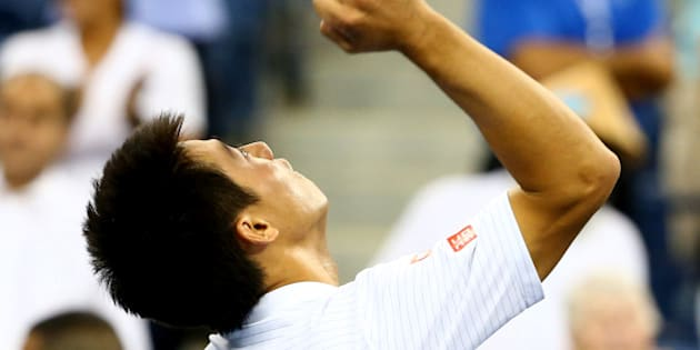 NEW YORK, NY - SEPTEMBER 03:  Kei Nishikori of Japan celebrates after defeating Stan Wawrinka of Switzerland in their men's singles quarterfinal match on Day Ten of the 2014 US Open at the USTA Billie Jean King National Tennis Center on September 3, 2014 in the Flushing neighborhood of the Queens borough of New York City. Nishikori defeated Wawrinka in five sets 3-6, 7-5, 7-6, 6-7, 6-4.  (Photo by Streeter Lecka/Getty Images)