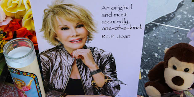 HOLLYWOOD, CA - SEPTEMBER 04:  Flowers placed on The Hollywood Walk of Fame Star in memory of TV personality/comedian Joan Rivers on September 4, 2014 in Hollywood, California.  (Photo by Paul Archuleta/FilmMagic)