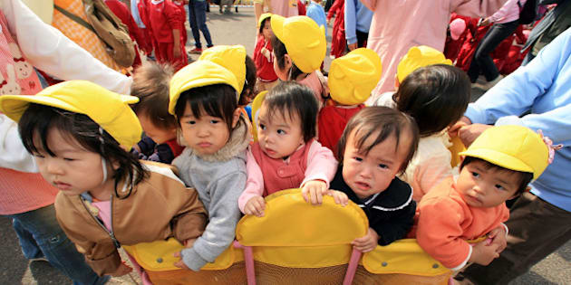 NAGOYA, JAPAN - NOVEMBER 09:  Children from a nursery school gather at the Port of Nagoya to see the arrival of two ships, Kaiwomaru and Nipponmaru to celebrate the 100 years anniversary of the Port on November 9, 2007 in Nagoya, Aichi Prefecture, Japan. The Port of Nagoya is the number one trade port in Japan, thanks to its location close to  the main office and factories of automobile giant Toyota.  (Photo by Junko Kimura/Getty Images)