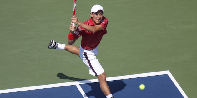 NEW YORK, NY - SEPTEMBER 6 :   Kei Nishikori of Japan returns the ball to Novak Djokovic of Serbia during their men's singles semifinal match on Day 13 of the 2014 US Open at the USTA Billie Jean King National Tennis Center in New York, United States on September 6, 2014.  (Photo by Bilgin Sasmaz/Anadolu Agency/Getty Images)