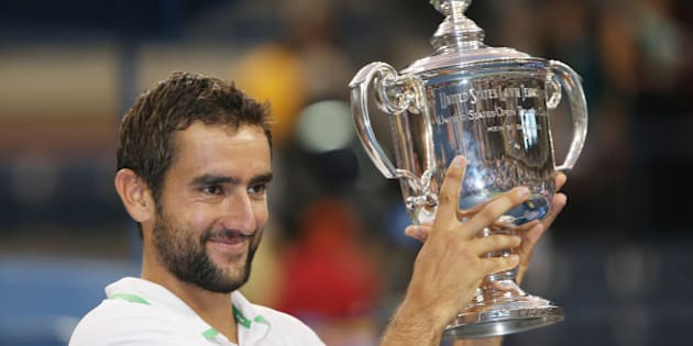 Marin Cilic, of Croatia, holds up the championship trophy after defeating Kei Nishikori, of Japan, in the championship match of the 2014 U.S. Open tennis tournament, Monday, Sept. 8, 2014, in New York. (AP Photo/Mike Groll)