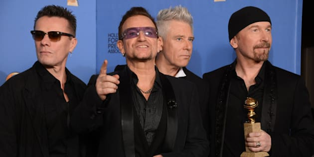 "From left, Larry Mullen Jr., Bono, Adam Clayton, and The Edge of U2 pose in the press room with the award for best original song for ""Ordinary Love"" from the film ""Mandela: Long Walk to Freedom"" at the 71st annual Golden Globe Awards at the Beverly Hilton Hotel on Sunday, Jan. 12, 2014, in Beverly Hills, Calif. (Photo by Jordan Strauss/Invision/AP)"