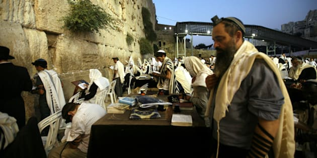 JERUSALEM, ISREAL - SEPTEMBER 2:  Jews praying in front of the Wailing Wall on  September 2, 2013 in Jerusalem. The Rosh Hashanah 2013, literally the head of the year in Hebrew, is celebrated  on September 5-6 by the Jews with special ceremonies. (Photo by Awad Awada/Anadolu Agency/Getty Images)