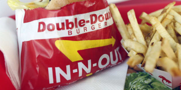 A Double-Double burger and french fries are arranged for a photograph at an In-N-Out Burger restaurant in Costa Mesa, California, U.S., on Wednesday, Feb. 6, 2013. In-N-Out, with almost 280 units in five states, is valued at about $1.1 billion based on the average price-to-earnings, according to the Bloomberg Billionaires Index. Photographer: Patrick T. Fallon/Bloomberg via Getty Images