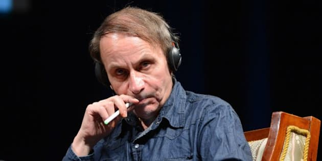 Honorary guest French novelist and poet Michel Houellebecq smokes an electric cigarette during a panel session after he was awarded with the Budapest Grand Prize at the 20th Budapest International Book Festival in Budapest, Hungary, Thursday, April 18, 2013. (AP Photo/MTI, Tamas Kovacs)