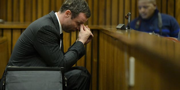 BY COURT ORDER, THIS IMAGE IS FREE TO USE.  PRETORIA, SOUTH AFRICA -AUGUST 8: Oscar Pistorius sits in the dock during closing arguments in his murder trial in the Pretoria High Court on August 8, 2014, in Pretoria, South Africa. Oscar Pistorius stands accused of the murder of his girlfriend, Reeva Steenkamp, on February 14, 2013. This is Pistorius' official trial, the result of which will determine the paralympian athlete's fate. (Photo by Herman Verwey/Pool/Foto24/Gallo Image/Getty Images)