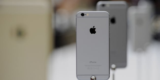 The new Apple Inc. iPhone 6 is displayed after a product announcement at Flint Center in Cupertino, California, U.S., on Tuesday, Sept. 9, 2014. Apple Inc. unveiled redesigned iPhones with bigger screens, overhauling its top-selling product in an event that gives the clearest sign yet of the company's product direction under Chief Executive Officer Tim Cook. Photographer: David Paul Morris/Bloomberg via Getty Images