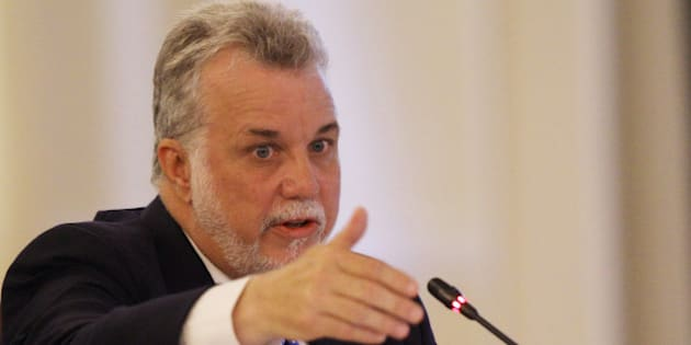 Premier Philippe Couillard of Quebec speaks at the New England Governors and eastern  Canadian Premiers 38th annual conference Monday, July 14, 2014, in Bretton Woods, N.H. Energy and economic collaboration were the main topics at Sunday and Monday's conference.  Eastern Canada is rich in hydropower while New England markets are eager to shore up supply and control some of the nation's highest energy costs.  (AP Photo/Jim Cole)