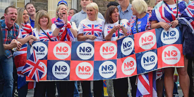 EDINBURGH, SCOTLAND - SEPTEMBER 13:  Members of the public watch Orangemen and women march during a pro union parade, less than a week before voters go to the polls in a yes or no referendum on whether Scotland should become and independent country on September 13, 2014 in Edinburgh, Scotland. An estimated 10,000 people have taken part in a Grand Orange Lodge of Scotland procession in support of the Union this morning.  (Photo by Jeff J Mitchell/Getty Images)