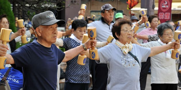Elderly people work out with wooden dumb-bells in the grounds of a temple in Tokyo on September 17, 2012 to celebrate Japan's Respect-for-the-Aged-Day. The estimated number of people aged 65 or older topped a record high of 30.74 million in Japan, passing the 30 million threshold for the first time ever, the government announced. AFP PHOTO / Yoshikazu TSUNO        (Photo credit should read YOSHIKAZU TSUNO/AFP/GettyImages)