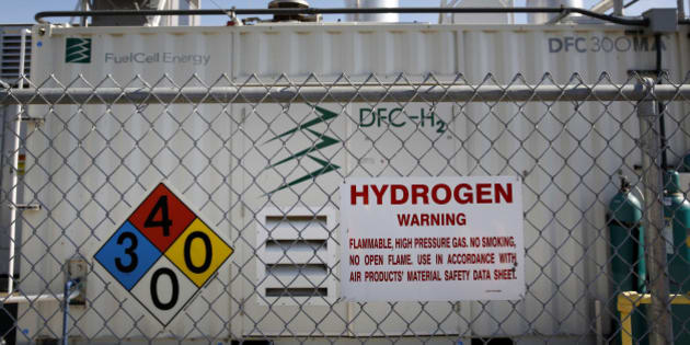 Warning signs are displayed as gas is produced in the tri-generation power and hydrogen system at the Orange County Sanitation District waste-treatment facility in Fountain Valley, California, U.S., on Wednesday, Feb. 5, 2014. California plans to spend $20 million a year for a decade for dozens of new hydrogen stations as carmakers including Hyundai, Toyota, Honda and Daimlers Mercedes-Benz try to entice Californians to buy fuel cell vehicles. Photographer: Patrick T. Fallon/Bloomberg via Getty Images
