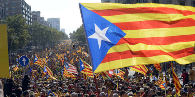 BARCELONA, SPAIN - SEPTEMBER 11: Catalans march during a Pro-Independence demonstration as part of the celebrations of the National Day of Catalonia on September 11, 2014 in Barcelona, Spain.  (Photo by Evrim Aydin/Anadolu Agency/Getty Images)