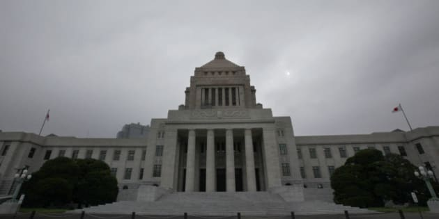 """The Diet building stands at dusk in Tokyo Tuesday, July 13, 2010. The Democrats' ruling coalition enjoys a comfortable majority in the powerful lower house, but it lost control of the upper house of parliament in the July 11 elections. If past experience holds, the """"twisted parliament"""" is a formula for policy gridlock, because the upper house must approve legislation. The """"twisted parliament"""" doesn't bode well for the country's future. (AP Photo/Shizuo Kambayashi)"""