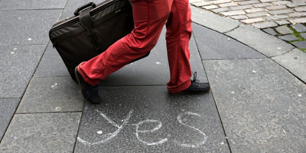A person walks by a message left by a member of the Yes campaign written on a pavement, in Edinburgh, Scotland, Wednesday, Sept. 17, 2014. The two sides in Scotland's independence debate are scrambling to convert undecided voters, with just one day to go until a referendum on separation. (AP Photo/Scott Heppell)