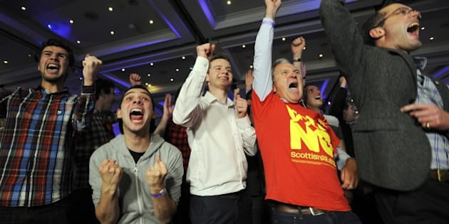 Pro-union supporters react as Scottish independence referendum results come in at a Better Together event in Glasgow on September 19, 2014. The question for voters at Scotland's more than 5,000 polling stations is 'Should Scotland be an independent country?' and they are asked to mark either 'Yes' or 'No'. The result is expected in the early hours of Friday. AFP PHOTO/ANDY BUCHANAN        (Photo credit should read Andy Buchanan/AFP/Getty Images)