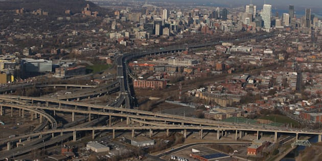 MONTREAL, QC - NOVEMBER 18: An aerial view of traffic on the Turcot Interchange and the Montreal skyline are seen from above on November 18, 2012 in Montreal, Quebec. (Photo by Tom Szczerbowski/Getty Images)