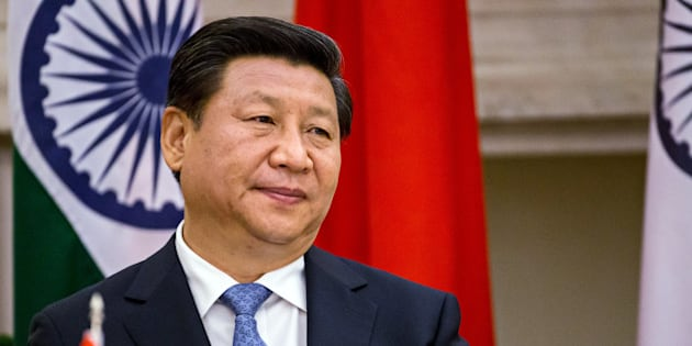 Xi Jinping, China's president, attends a meeting with Narendra Modi, India's prime minister, unseen, to sign a series of agreements between the two nations at Hyderabad House in New Delhi, India, on Thursday, Sept. 18, 2014. Modi won a pledge from Xi to invest $20 billion as the leaders sought to adjust a lopsided trade relationship and resolve a decades-long border dispute. Photographer Graham Crouch/Bloomberg via Getty Images
