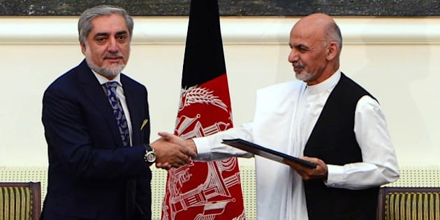 Afghan presidential candidates Abdullah Abdullah (L) and Ashraf Ghani Ahmadzai shake hands after signing a power-sharing agreement at the Presidential Palace in  Kabul on September 21, 2014. Afghanistan's two rival presidential candidates signed a power-sharing deal on September 21, ending a prolonged stand-off over disputed election results at a pivotal moment in the war-weary nation's history. AFP PHOTO/Wakil Kohsar        (Photo credit should read WAKIL KOHSAR/AFP/Getty Images)