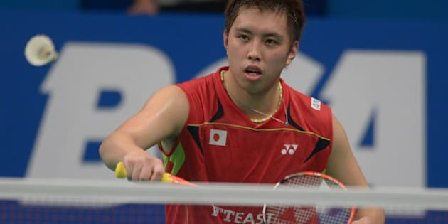 Kenichi Tago of Japan hits a return against Lee Chong Wei of Malaysia at the  badminton 2014 Indonesia Open men singles semi-final match in Jakarta on June 21, 2014. Kenichi Tago won 21-16, 15-21, 21-16. AFP PHOTO / ADEK BERRY        (Photo credit should read ADEK BERRY/AFP/Getty Images)