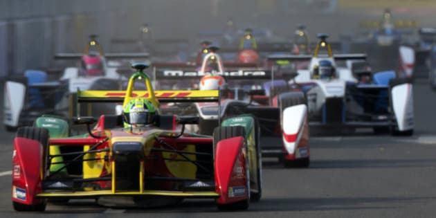 Audi Sport ABT's Lucas di Grassi of Brazil races ahead at the start of the inaugural Formula E all-electric auto race in Beijing Saturday, Sept. 13, 2014.  Di Grassi crossed the finish line first to win the event.(AP Photo/Ng Han Guan)