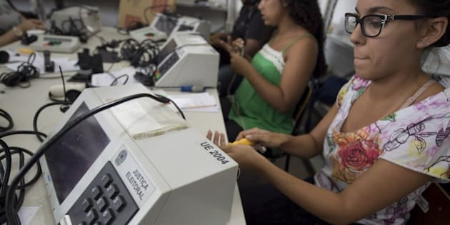 Workers prepare the electronic polling stuff for  October 5th general elections at the regional electoral tribunal in Rio de Janeiro, Brazil on september 24, 2014. AFP PHOTO/VANDERLEI ALMEIDA        (Photo credit should read VANDERLEI ALMEIDA/AFP/Getty Images)