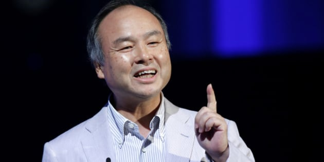 Masayoshi Son, chairman and chief executive officer of SoftBank Corp., gestures as he speaks at SoftBank World 2014 in Tokyo, Japan, on Tuesday, July 15, 2014. As Son pushes for a takeover of T-Mobile US Inc., the Japanese billionaire is asking banks to commit financing for a longer-than-usual amount of time, underscoring the intense regulatory review he faces. Photographer: Kiyoshi Ota/Bloomberg via Getty Images