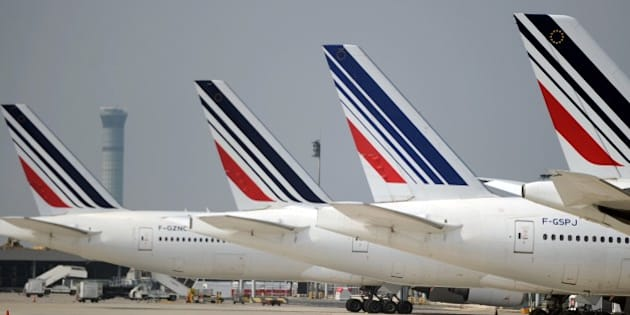 Air France planes are parked on the tarmac of Charles de Gaulle airport on September 24, 2014 in Roissy, north of Paris, on the 10th day of Air France's pilots strike against the company's plan to develop its low-cost subsidiary. AFP PHOTO / STEPHANE DE SAKUTIN        (Photo credit should read STEPHANE DE SAKUTIN/AFP/Getty Images)