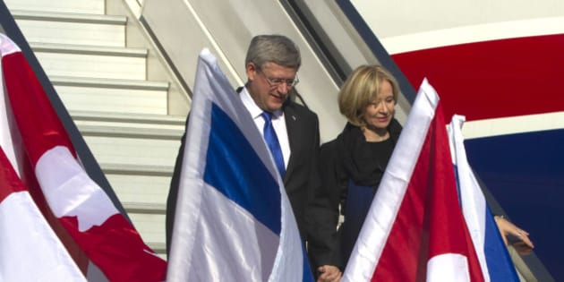 Canadian Prime Minister Stephen Harper and his wife Laureen arrive at Ben Gurion Airport near Tel Aviv, Israel, Sunday, Jan. 19, 2014. Harper is on an official four-day visit to Israel. (AP Photo/Heidi Levine, Pool)