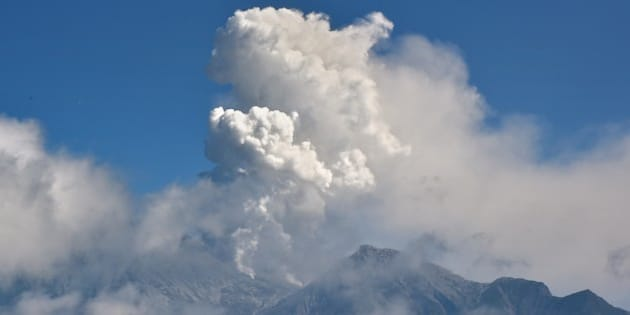 A cloud of volcanis ash rise from Mount Ontake seen from Gifu prefecture on September 28, 2014.  More 30 hikers were found in 'cardiac arrest' near the peak of the erupting volcano in Japan police said. The eruption of the 3,067-metre (10,121-foot) Mount Ontake happened around midday, the meteorological agency said.  AFP PHOTO / KAZUHIRO NOGI        (Photo credit should read KAZUHIRO NOGI/AFP/Getty Images)