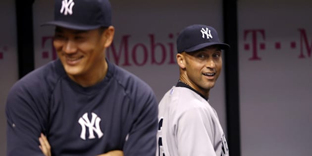 ST. PETERSBURG, FL - SEPTEMBER 16:  Pitcher Masahiro Tanaka #19 of the New York Yankees and shortstop Derek Jeter #2 laugh together in the dugout before the start of a game against the Tampa Bay Rays on September 16, 2014 at Tropicana Field in St. Petersburg, Florida.  (Photo by Brian Blanco/Getty Images)