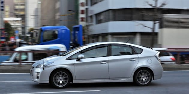 Japanese auto giant Toyota Motor's hybrid vehicle Prius is driven on a street in Tokyo on February 12, 2014. Toyota announced a global recall of 1.9 million Prius hybrid cars because of a fault that could cause the vehicle to slow down suddenly, in the latest safety blow to the Japanese auto giant. AFP PHOTO / Yoshikazu TSUNO        (Photo credit should read YOSHIKAZU TSUNO/AFP/Getty Images)