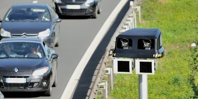 Motorists drive by a radar part of  an average speed measuring system, on June 23, 2014 near Englos, northern France. This system operates as sets of two or more cameras installed along a fixed route which can calculate the average speed of a vehicle between these sites. AFP PHOTO PHILIPPE HUGUEN        (Photo credit should read PHILIPPE HUGUEN/AFP/Getty Images)