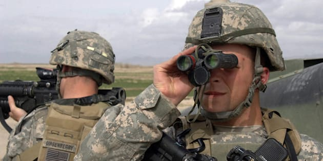 "U.S. Army Sgt. Joseph Evans scans the area through a pair of binoculars while Spc. Brendon Quisenberry pulls rear security during a security halt on a route reconnaissance mission near Mir-e, Afghanistan, April 4, 2007. The Soldiers are from Headquarters and Headquarters Company, 2nd Battalion, 508th Parachute Infantry Regiment. (U.S. Army photo by Staff Sgt. Michael L. Casteel) <a href=""http://www.army.mil"">www.army.mil</a>"