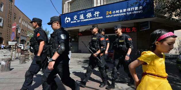 Chinese armed police patrol the streets of the Muslim Uighur quarter in Urumqi after a series of recent terrorist attacks hit Xinjiang Province on June 29, 2013.  China's state-run media on June 29 blamed around 100 people it branded as 'terrorists' for sparking 'riots' in the ethnically-divided region of Xinjiang, where clashes killed 35 days earlier.         AFP PHOTO / Mark RALSTON        (Photo credit should read MARK RALSTON/AFP/Getty Images)