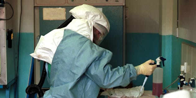 386640 04: Linda Pezzanite, a microbiologist working for the CDC, Centers for Disease Control, tests blood samples for the Ebola virus while wearing a protective suit February 2001 at St. Mary's Hospital in Lacor, Uganda. Nearly 200 people died in northern Uganda in this latest outbreak of Ebola. (Photo by Tyler Hicks/Liaison)