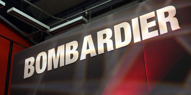 A Bombardier logo sits on a presentation platform at Bombardier Inc.'s Litchurch Lane railcar factory in Derby, U.K., on Thursday, May 15, 2014. Bombardier's transportation unit won $8 billion of new business in the first three months of 2014 and had a record backlog of $38.4 billion, including a $2.1 billion train deal with Transport for London. Photographer: Chris Ratcliffe/Bloomberg via Getty Images