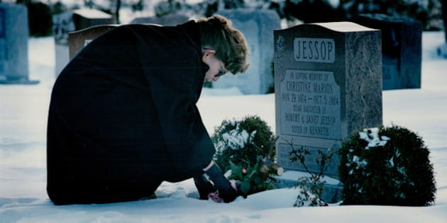 CANADA - FEBRUARY 14:  Remembering Christine: Janet Jessop places a single red rose on the grave of her daughter Christine; 9; in the Queensville cemetery. Christine was murdered in 1984   (Photo by Jim Rankin/Toronto Star via Getty Images)