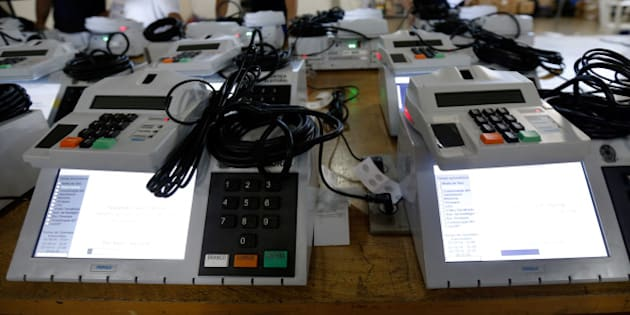 Electoral technicians finalize preparation of electronic voting machines to be used in the upcoming general elections, in Brasilia, Brazil, Wednesday, Oct. 1, 2014. Brazil will hold general elections on Oct. 5. (AP Photo/Eraldo Peres)