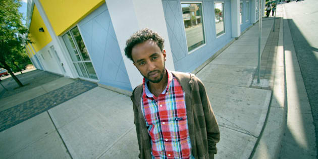 09/14/10 - TORONTO, ONTARIO - Nahom Berhane, of the centre, stands outside the colorful building. Access Point on Danforth is a centre which brings together a number of services from health care to youth programs, and greatly serves newcomers to Canada. (Photo by Rick Madonik/Toronto Star via Getty Images)