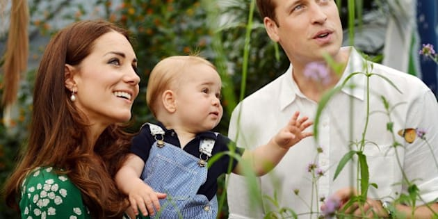 A photograph taken in London on Wednesday July 2, 2014, to mark Britain's Prince George's first birthday, shows Prince William (R) and Catherine, Duchess of Cambridge (L) with Prince George during a visit to the Sensational Butterflies exhibition at the Natural History Museum in London. Britain's Prince William and his wife Catherine on Monday thanked well-wishers around the world as they prepared to celebrate their son Prince George's first birthday. AFP PHOTO/John Stillwell/POOL EDITORIAL USE ONLY        (Photo credit should read JOHN STILLWELL/AFP/Getty Images)