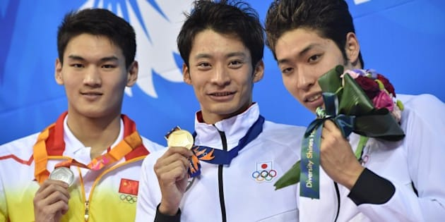 (L-R) Silver medallist China's Xu Jiayu, gold medallist Japan's Ryosuke Irie and bronze medallist Japan's Kosuke Hagino pose on the podium during the victory ceremony for the men's 200m backstroke swimming event during the 17th Asian Games at the Munhak Park Tae-hwan Aquatics Centre in Incheon on September 25, 2014.  AFP PHOTO / PHILIPPE LOPEZ        (Photo credit should read PHILIPPE LOPEZ/AFP/Getty Images)