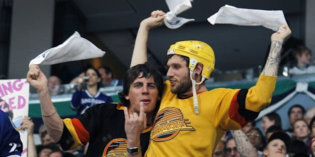 VANCOUVER, CANADA - APRIL 23:  Vancouver Canuck fans wave towels in Game Five of the Western Conference Quarterfinals between the Vancouver Canucks and the Los Angeles Kings during the 2010 Stanley Cup Playoffs at General Motors Place on April 22, 2010 in Vancouver, British Columbia, Canada.  Vancouver won 7-2. Photo by Jeff Vinnick/NHLI via Getty Images)