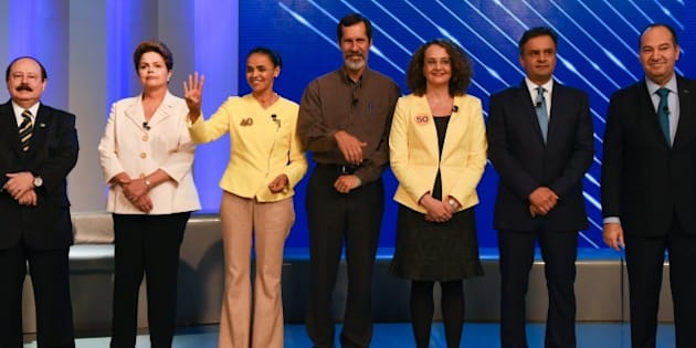 Brazilian Presidential candidates, Brazilian President and candidate for the Workers Party (PT) Dilma Rousseff (2nd L), for the Brazilian Socialist Party (PSB) Marina Silva (3rd L), for the Brazilian Social Democracy Party (PSDB), Aecio Neves (2nd R), for the Brazilian Labour Renewal Party (PRTV), Levy Fidelix (L), for the Green Party (PV), Eduardo Jorge (C), for the Socialism and Freedom Party (PSOL), Luciana Genro (3rd R), for the Social Christian Party (PSC), Pastor Everaldo pose for photographers before their last TV debate in Rio de Janeiro, Brazil, on October 2, 2014. The general election will be held on October 5, 2014.  AFP PHOTO / YASUYOSHI CHIBA        (Photo credit should read YASUYOSHI CHIBA/AFP/Getty Images)