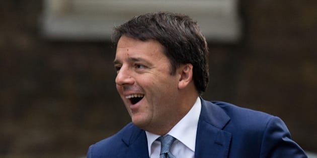 Italy's Prime Minister Matteo Renzi smiles upon seeing British Prime Minister David Cameron as he gets out from a car upon his arrival for their meeting at 10 Downing Street in London, Thursday, Oct. 2, 2014.  (AP Photo/Matt Dunham)