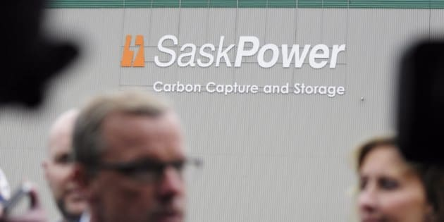 Saskatchewan premier Brad Wall speaks to the media during the official opening of a carbon capture and storage facility at the Boundary Dam Power Station in Estevan, Saskatchewan, Thursday, Oct. 2, 2014. SaskPower said more than 250 people from at least 20 countries attended the unveiling of the $1.4-billion facility that is to take carbon dioxide released by the Boundary Dam power plant near Estevan and release the gas deep underground using a steel pipeline for storage. (AP Photo/The Canadian Press, Michael Bell)