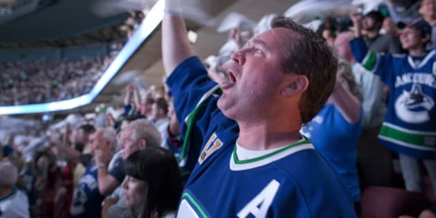 A Vancouver Canucks fan cheers at the start of Game 2 of the NHL hockey Stanley Cup Finals against the Boston Bruins, Saturday, June 4, 2011, in Vancouver, British Columbia. (AP Photo/Julie Jacobson)