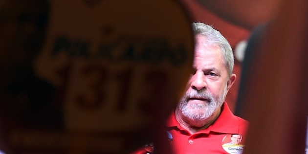 Former Brazilian President (2003-2011) Luiz Inacio Lula da Silva attends a rally of the Workers Party, in Ceilandia, Brasilia, Brazil on September 25, 2014. The Brazilian general elections will take place next October 5. AFP PHOTO/EVARISTO SA        (Photo credit should read EVARISTO SA/AFP/Getty Images)